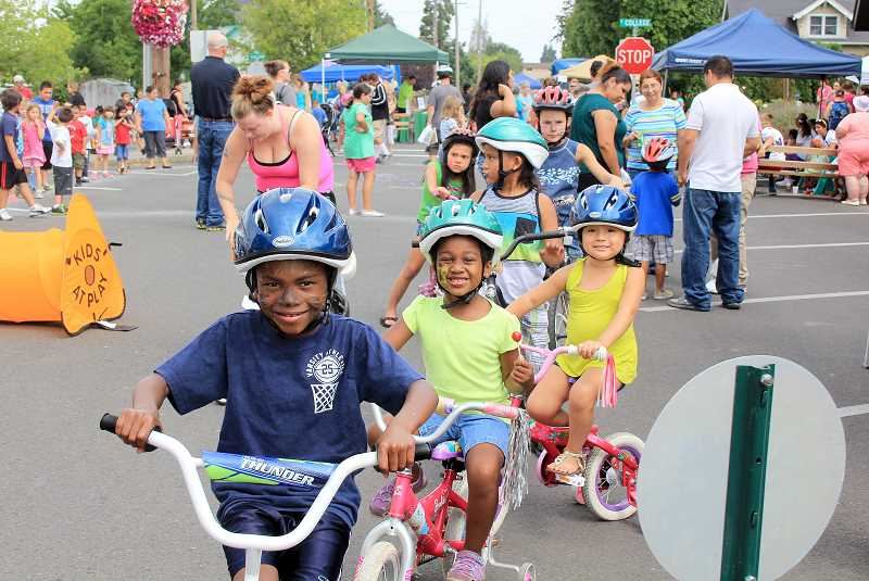 by: JEFF MCDONALD  - Gabriel and Maggie James of Woodburn lead off the Mount Angel Bike Rodeo Friday.