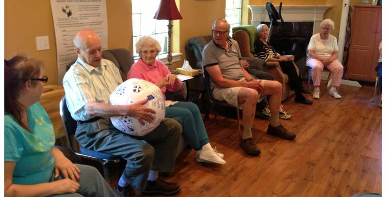 by: JOHN BAKER - A respite class at Thelmas's Place participates in a program run by Patsy Dean and Lindsay Brady.