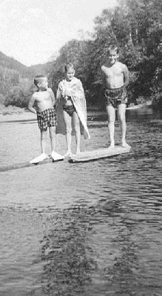by: SUBMITTED  - The Kelly boys pose on the diving board above the deep part of the family swimming hole some time in the mid-1950s. They are, from left, Patrick, Robert and Mikel.