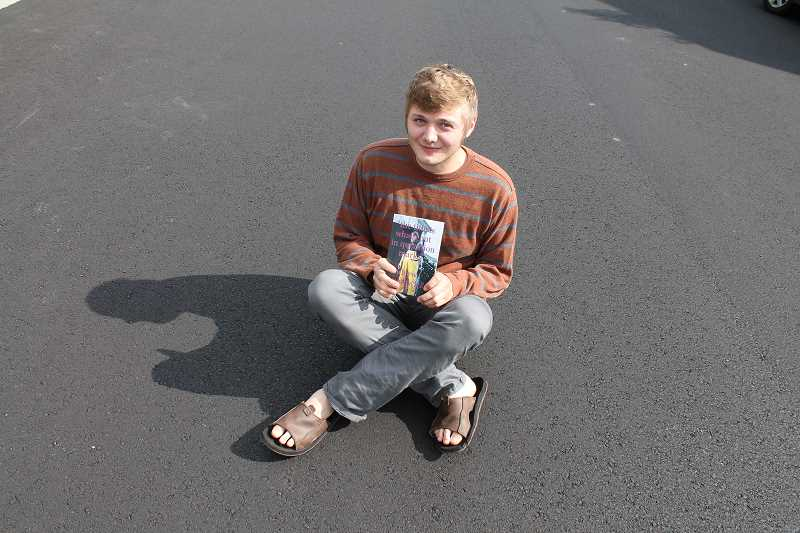 by: EMILY HOARD - Andrew Mathwick sits in the middle of the street, just like his character did in the book.