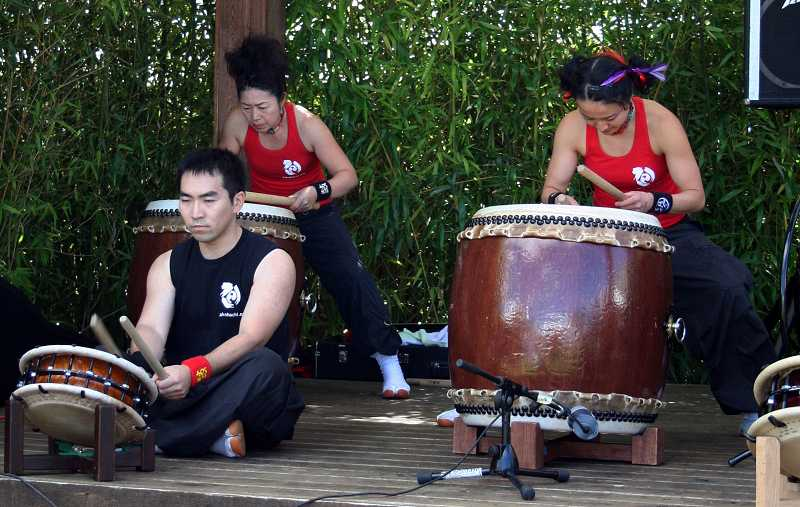 by: NEWS-TIMES FILE PHOTO: CHASE ALLGOOD - Drummers provide rhythm during the 2012 Pacific Rim Festival, which drew more than 1,000.