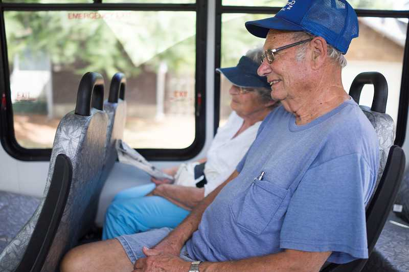 by: NEWS-TIMES PHOTO: CHASE ALLGOOD - Ron and Donna Quay of Forest Grove enjoy a free ride around the city Monday as they try out the new GroveLink bus service operated by Ride Connection. The Quays said they discovered new areas of town along the often scenic bus route.