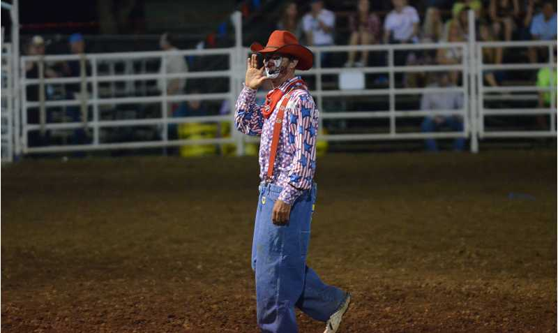 by: JEFF GOODMAN - Award-winning rodeo entertainer Keith Isleys energizes the crowd during the 56th-annual Canby Rodeo. Isleys act includes a variety of tricks and jokes, including political satire.