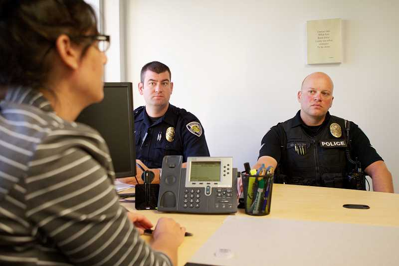by: TIMES PHOTO: JAIME VALDEZ - Beaverton Police Department Officers Sean Hinkley and Matt Kingsbury often check in with Jennifer Rivas, the B-SOBR program's court case manager, on the status of program participants after they conduct a home visit.