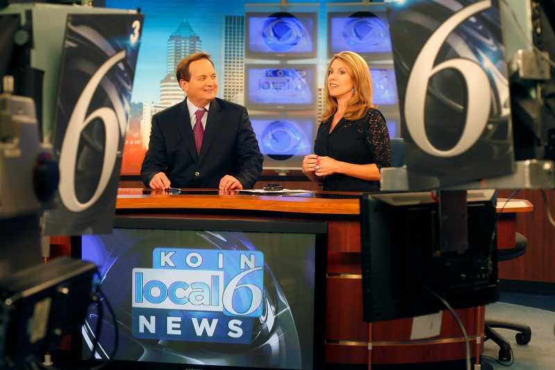 by: TIMES PHOTO: JONATHAN HOUSE - KOIN anchor Jeff Gianola chats with his co-host Kelley Day prior to the start of the evening newscast. The Tigard resident is celebrating his 30th year in Portland this year.