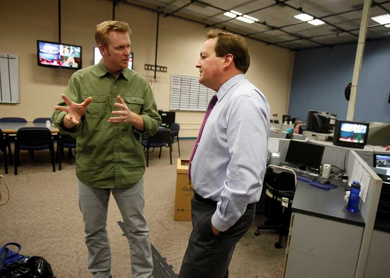 by: TIMES PHOTO: JONATHAN HOUSE - KOIN digital director Jason Vosburgh goes over the stations online strategy with anchor Jeff Gianola, prior to the start of his afternoon broadcast.