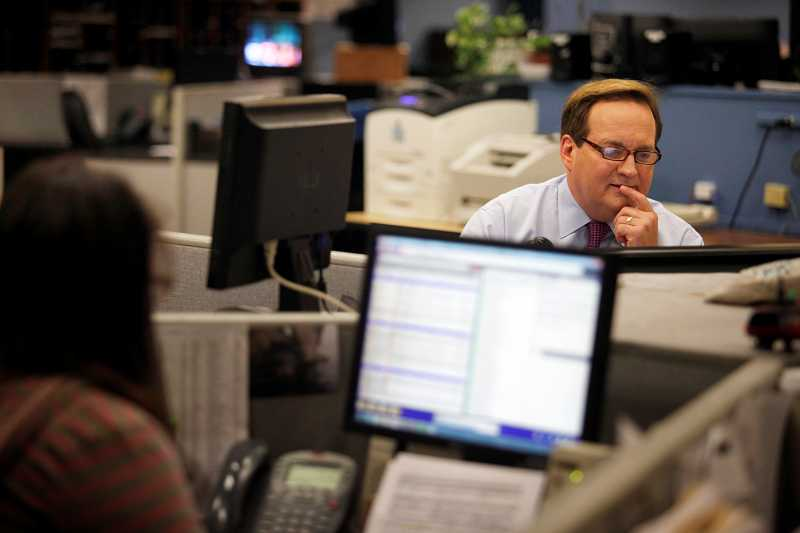 by: TIMES PHOTO: JONATHAN HOUSE - KOIN anchor Jeff Gianola edits a story before going  evening broadcast in the newsroom. Gianola said he strives to make every story he reads conversational. 'If I don't get it in the first sentence, I'm going back and changing stuff.'