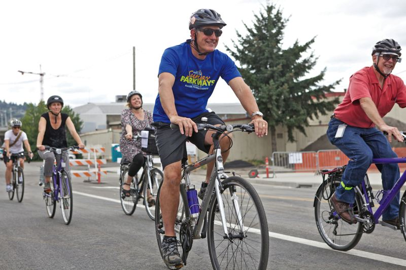 by: TRIBUNE PHOTO: JAIME VALDEZ - Mayor Charlie Hales and a dozen city staff mounted bikes to tour areas ripe for development due to TriMets new Portland-Milwaukie MAX line.