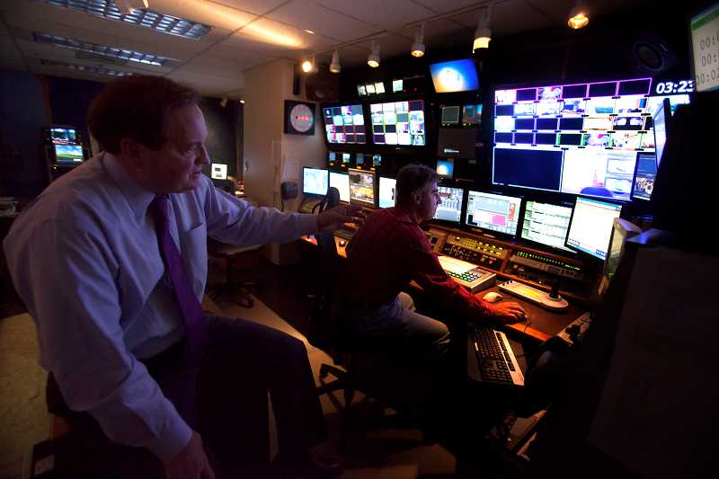 by: TIMES PHOTO: JONATHAN HOUSE - KOIN anchor Jeff Gianola watches director Tom Westarp prepare for the evenings news broadcast.
