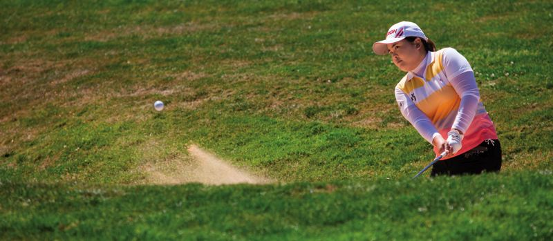 by: TRIBUNE FILE PHOTO: CHRISTOPHER ONSTOTT  - Inbee Park of South Korea blasts out of a bunker during the 2012 Safeway Classic, in which she tied for second. Park is the runaway choice for player-of-the-year honors in womens golf this season.