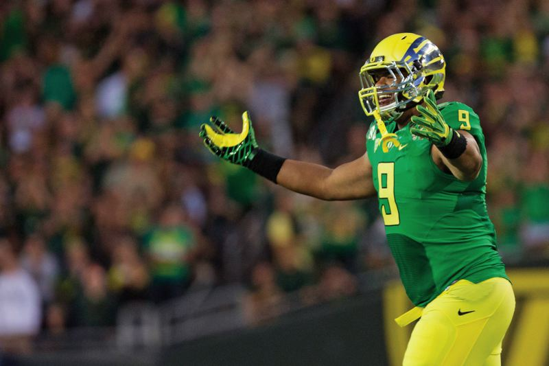 by: TRIBUNE FILE PHOTO: CHRISTOPHER ONSTOTT - Arik Armstead is one of several Oregon Ducks prepared to take turns and make an impact in the defensive line this season.