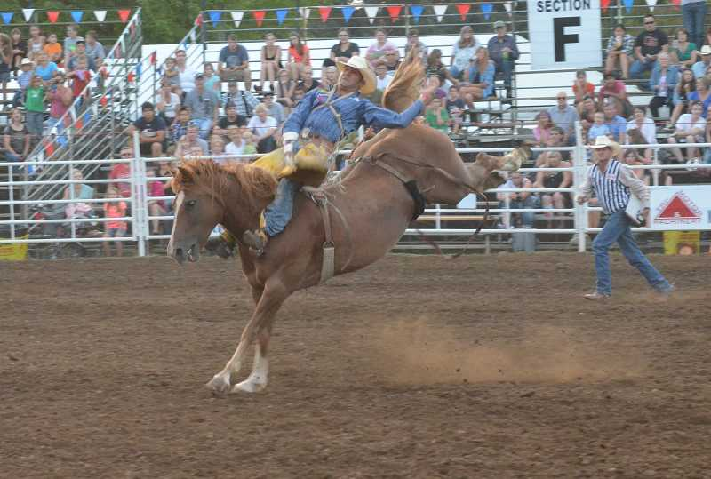 by: JEFF GOODMAN - Bobby Mote, the all-around champion of the Canby Rodeo in 2012, competes in bareback riding Aug. 13 at the Clackamas County Fairgrounds. Rodeo star Trevor Brazile claimed the all-around title this year.