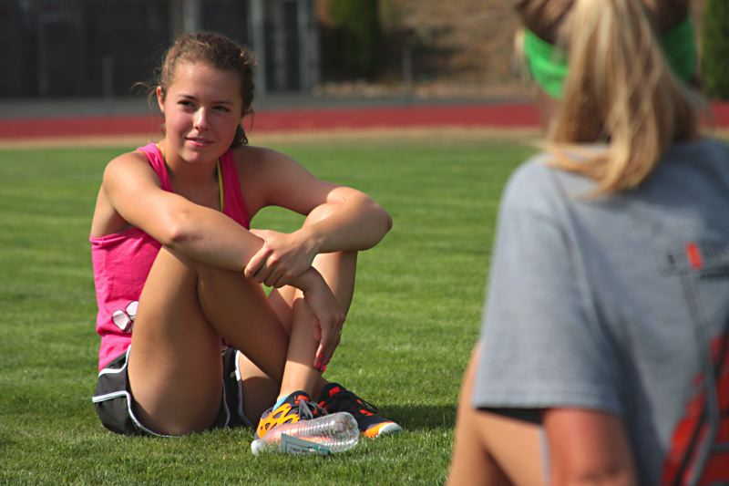 by: JOHN WILLIAM HOWARD - Sophomore Macy Gray sits and listens during a team discussion on Wednesday morning. Gray will participate in the Portland to Coast challenge for the first time on Friday.