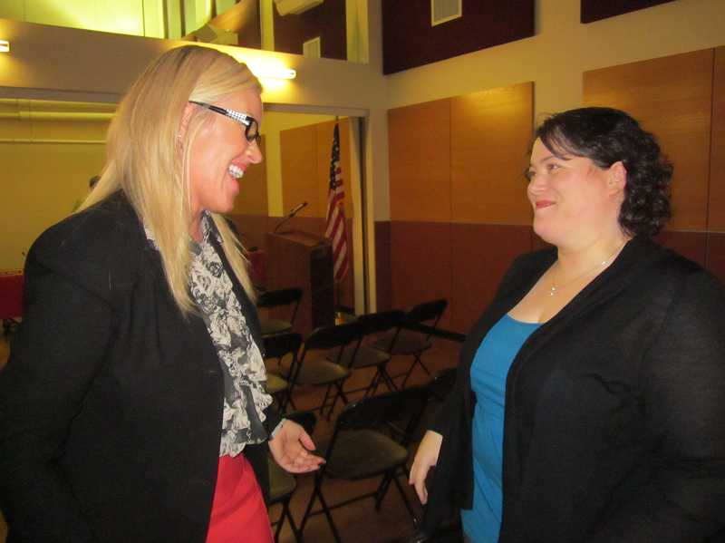 by: FILE PHOTO BY BARBARA SHERMAN - Superintendent Heather Cordie, left, chats with Jessica Adamson after she was appointed to the Sherwood School Board last fall.