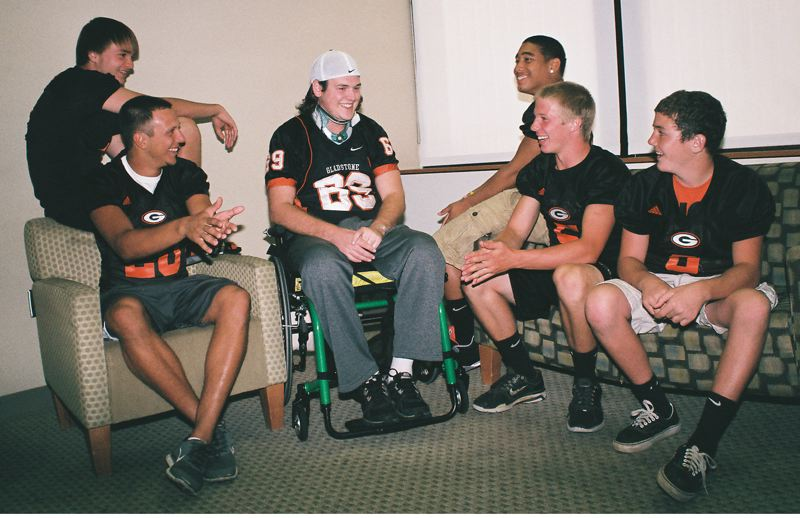 by: JOHN DENNY - Gladstone High School senior football players stopped by the Rehabilitation Institute of Oregon at Legacy Good Samaritan Hospital last week to hang out with Jake Wheeler, who graduated from Gladstone in 2008. Wheeler is undergoing rehabilitation for a spinal cord injury. The Gladstone community has rallied behind the former three-sport athlete, with multiple fundraisers. This Fridays home football game with Astoria is an endowment game and half of the gate receipts will go to help Wheeler with his recovery. Pictured with Wheeler are (from left) Sean Williams, Andrew Conway, Vinny Rininger, Trevor Browning and Blake McNall.