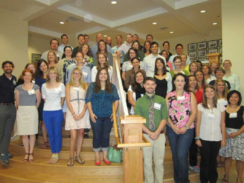 by: SUBMITTED PHOTO - New teachers and administrators report for a welcome session at the district offices Aug. 22.