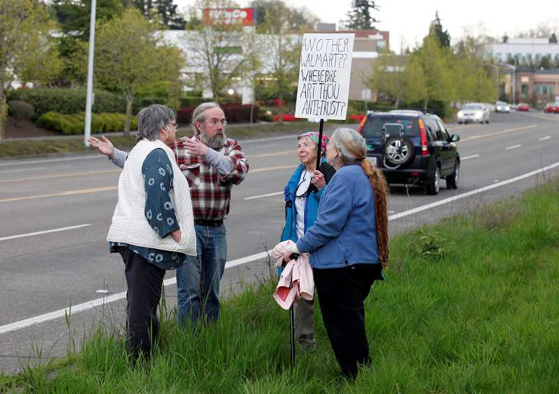 by: JON HOUSE - Protestors picket outside the a proposed Walmart site on Southwest Dartmouth Street in April. The group has gone on to form their own political advocacy group, Tigard First, to change the way the city does business after it allowed the Walmart to come to town.
