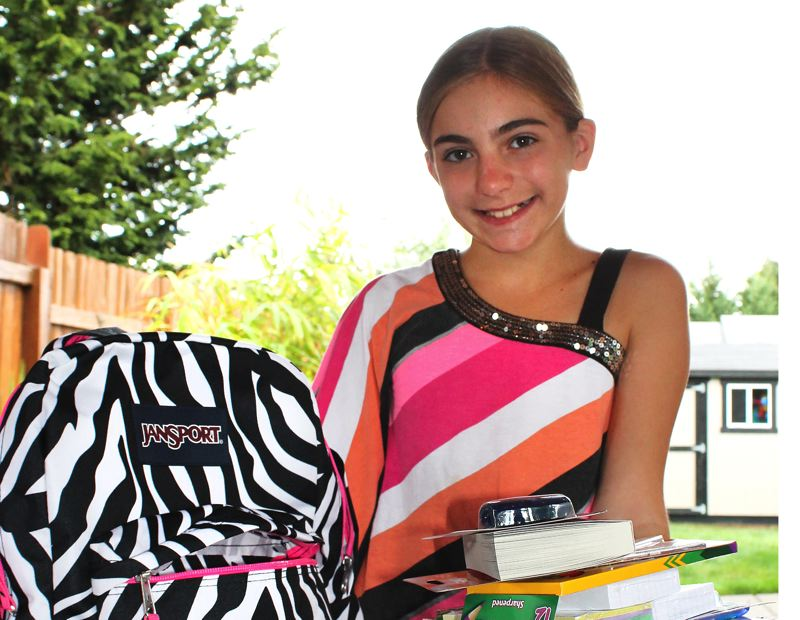 by: OUTLOOK PHOTO: ANNE ENDICOTT - Soon-to-be seventh-grader Emie McNicholas will use every pocket in her new backpack just to get all her supplies to the classroom when school starts next week.