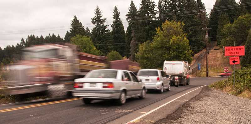 by: JOSH KULLA - The intersection of Tonquin and Grahams Ferry roads is slated for major improvement under the transportation refinement plan adopted Aug. 5 by the Wilsonville City Council.