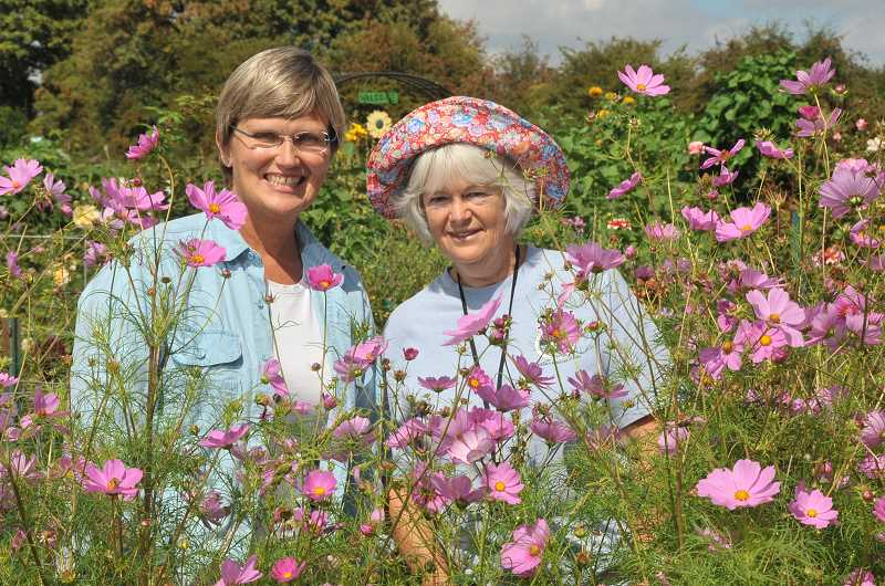 by: VERN UYETAKE - Dawn Grunwald, left, and Karen Davis show just a taste of the colors that people will experience at third annual Luscher Farm Open House on Sept. 7.