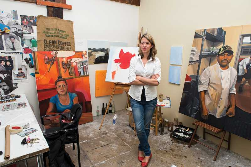 by: TIMES PHOTO: CHASE ALLGOOD - Natalie Sept, district representative for U.S. Congresswoman Suzanne Bonamici (D-Ore.) in Washington County, spents her off-hours at Falcon Art Community in Northeast Portland, where she creates vivid portraits of workers she has encountered at home and abroad. Her website is nataliesept.com.