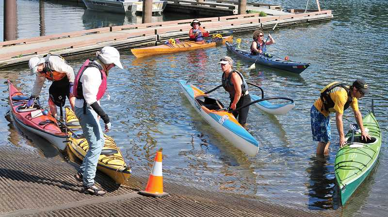 by: GARY ALLEN - Sunburned, but happy - The annual trip Paddle Oregon sees 140 people make the 107-miles trip down the Willamette River to Roger's Landing in Newberg.