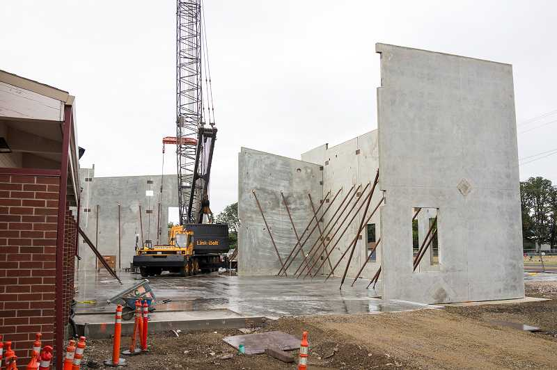 by: NEWS-TIMES PHOTO: CHASE ALLGOOD - The wall raising on Banks' school campus went smoothly last Monday, Aug. 26, despite the rain.