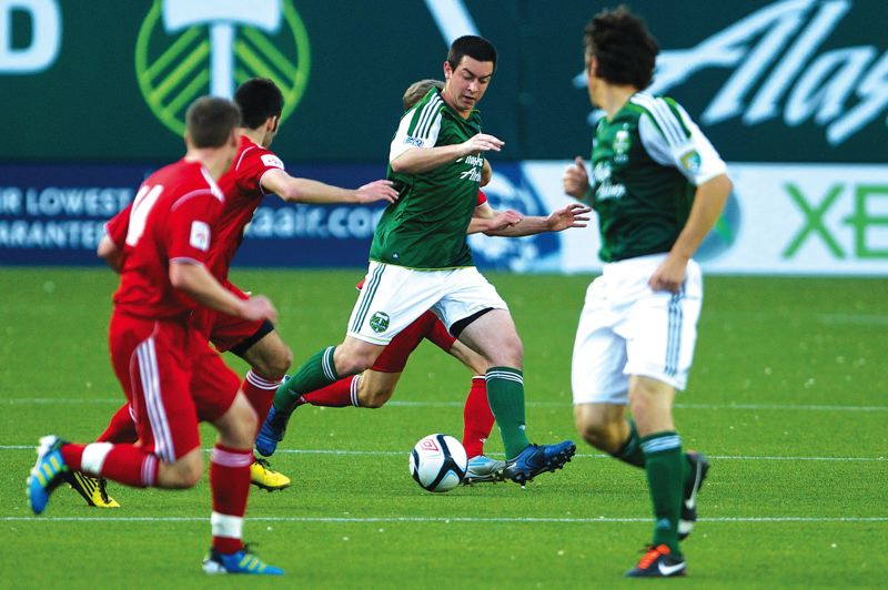 by: PAMPLIN MEDIA GROUP  - Troutdales Steven Evans races through the midfield during a match last summer. He has moved into a starters role with the Timbers reserves squad this year.