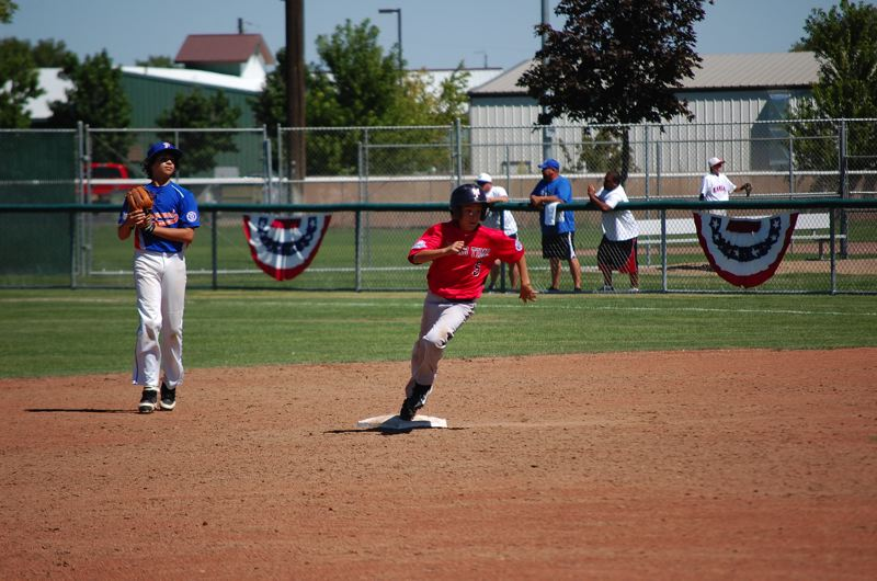 by: COURTESY PHOTO: MAUREEN BLAIR - MoundTime 14Us Andrew Blair rounds second base at the Babe Ruth Little League World Series in Moses Lake, Wash. MoundTime 14U took second the nation.