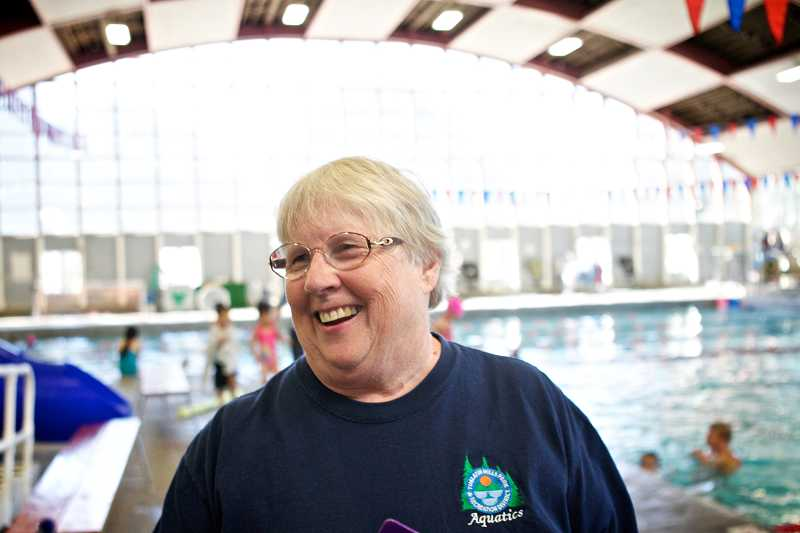 by: TIMES PHOTO: JAIME VALDEZ - Sharron Patapoff, shown here in her natural work environment at the Beaverton Swim Center on Southwest Third Street, is retiring as the center's supervisor just before the facility shuts down for renovations.