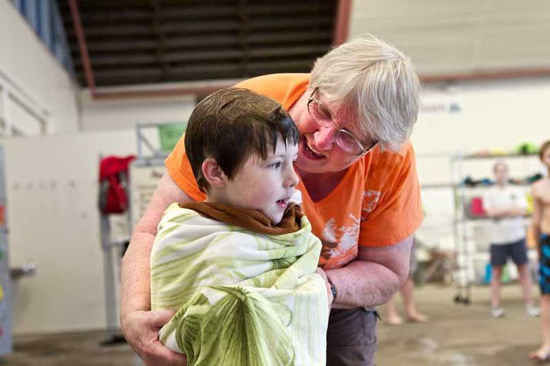 by: TIMES PHOTO: JAIME VALDEZ - Sharron Patapoff, supervisor at the Beaverton Swim Center, hugs her grandson, Dexter, 4, after his swim lessons at the center. Patapoff is about to retire after 30 years in her supervisory role.