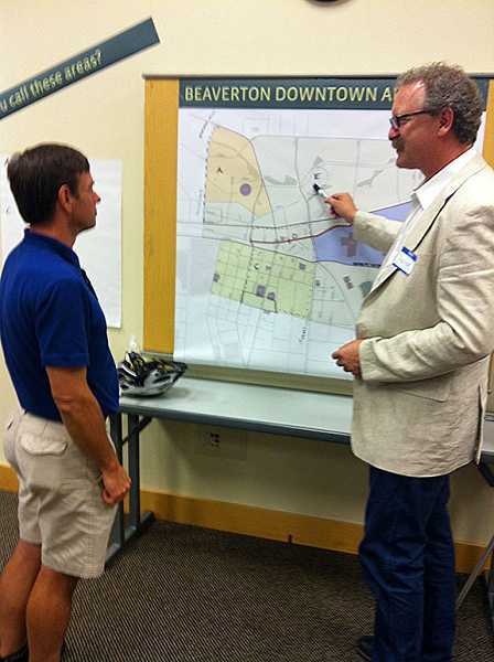by: CONTRIBUTED PHOTO: CHARLES JURASZ - Brian Walker, chairman of the Beaverton Bicycle Advisory Committee, shares thoughts on the proposed way-finding sign plan for the city with Peter Reedijk, design director at Sea Reach Ltd., at a workshop on Monday evening at the Beaverton City Library.