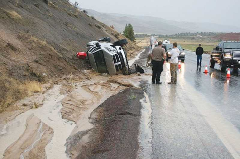 by: SUBMITTED PHOTO - Mud on U.S. Highway 97, at milepost 79, contributed to a three-vehicle crash on Sunday, during the storm.