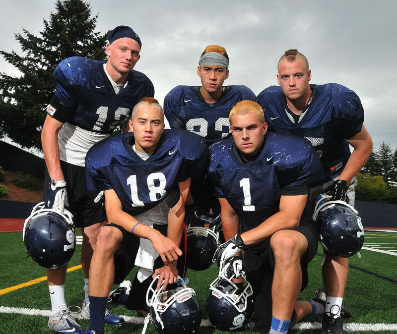 by: VERN UYETAKE - From left: Jordan Horak, Zach Parker, Kenny Oyama, Nick Underwood and Collin Calhoon will all be part of a talented but unproven Lake Oswego football team that is coming off back-to-back appearances in the state championship game.