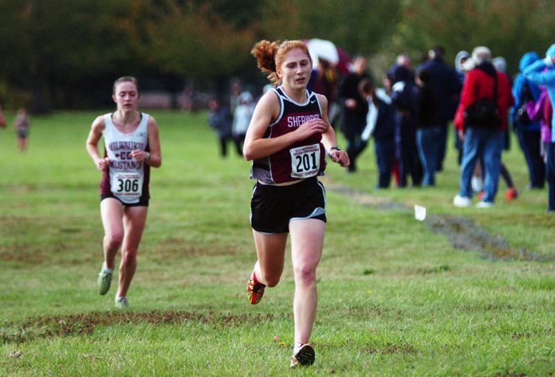 by: DAN BROOD - THE CAPTAIN -- Senior Avery Rosenbalm, shown here at last year's NWOC district meet, will serve as team captain for the Sherwood girls.