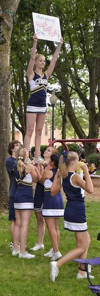by: RAY HUGHEY - The Canby High School cheerleaders peddle root beer floats in Wait Park.