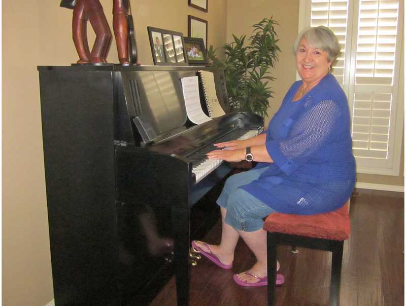 by: BARBARA SHERMAN - MORE MUSIC ON THE WAY - Suzanne Short often plays the piano in her Highlands home when she isn't performing around the metro area.