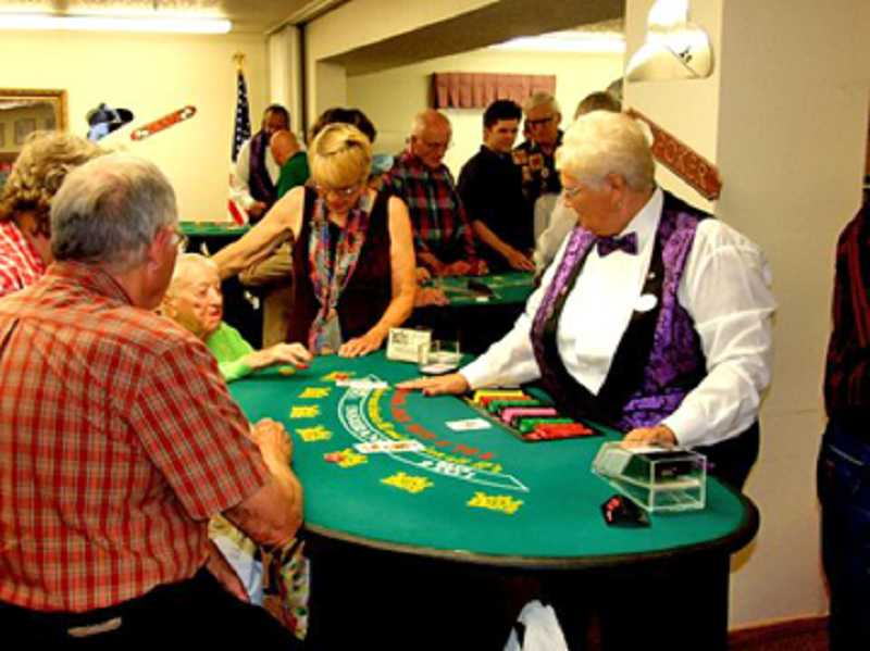by: LARRY TORREY/FOR THE REGAL COURIER - GAME NIGHT - At the King City Lions' Club first Western BBQ & Casino Night, fun was had by all, including gamblers gathered around the gaming tables, such as Elsie Battaglia and Claudia Carlson (center).