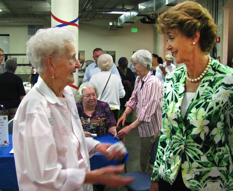 by: OUTLOOK PHOTO: MARA STINE - Commissioner Diane McKeel has become known among her peers on the board of commissioners as a champion for county staff. Here she congratulates Jeanne Hass, 88, of Southeast Portland, who has worked as a temporary elections division employee, for 33 years, at a party held in their honor.