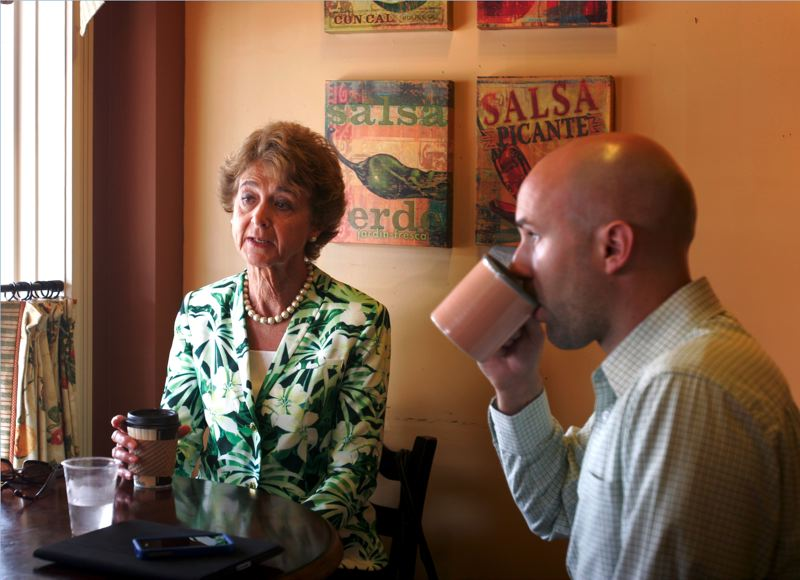 by: OUTLOOK PHOTO: JIM CLARK - A long-time advocate of local businesses in the small towns that make up East Multnomah County, Commissioner Diane McKeel meets with her Chief of Staff Eric Zimmerman at Celebrate Me Home in downtown Troutdale to go over her schedule while fueling up on coffee.