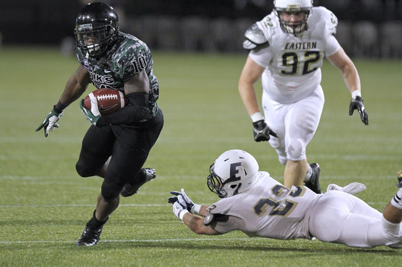 by: TRIBUNE PHOTO: JONATHAN HOUSE - Portland State running back DJ Adams makes an Eastern Oregon defender miss on his way to a big gain in Thursday night's 57-17 victory over the Mountaineers at Jeld-Wen Field.