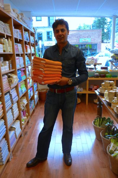 by: CONNECTION PHOTO: DREW DAKESSIAN - Indigo Traders co-owner Samir Naser with the Multnomah Village shop's staple, hand-woven Turkish towels.