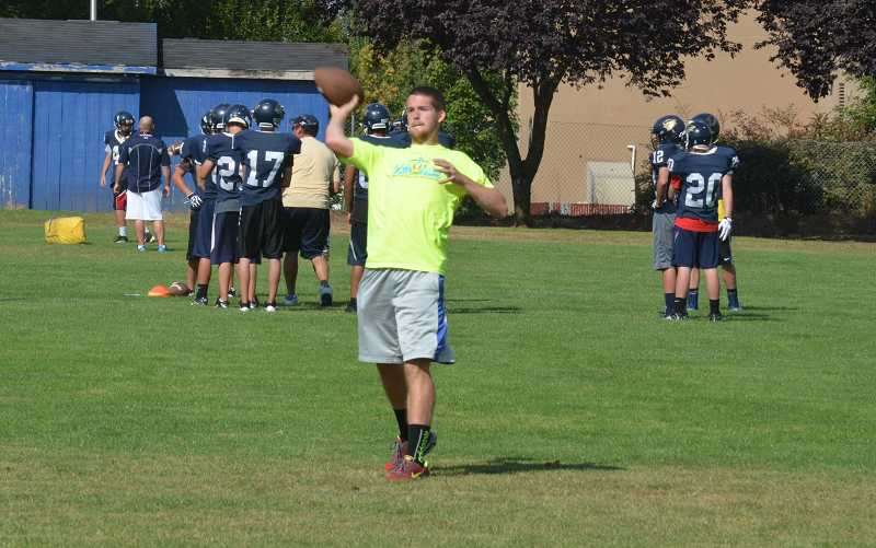 by: JEFF GOODMAN - Timmy Johnson throws a pass during a drill for receivers and defensive backs at the Canby football team's Aug. 21 practice. He will likely miss the entire season after having surgery to repair a heart defect.