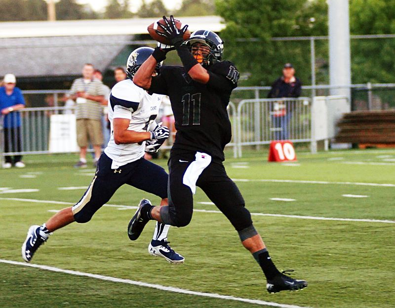 by: DAN BROOD - NICE CATCH -- Tigard senior receiver Daren Rodrigues pulls in a 38-yard pass from senior quarterback Jett Even in the second quarter of the Tigers' 38-7 victory.