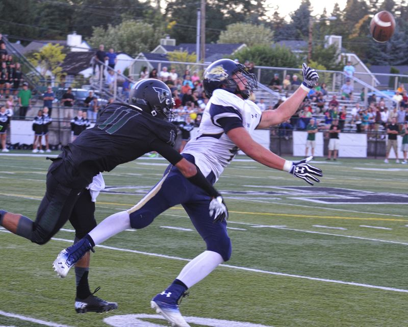 by: JEFF GOODMAN - A.J. Schlatter tries to reel in a pass Aug. 30 during the Canby football team's 38-7 defeat at Tigard. The Cougars have lost to the Tigers three times in the last 12 months.