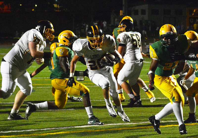 by: JOHN WILLIAM HOWARD - Senior running back Brennan Norton charges into the end zone during the third overtime of St. Helens' thrilling victory over Cleveland on Friday, Aug. 30. Norton had a pair of touchdowns in the game, one on the ground and one through the air.