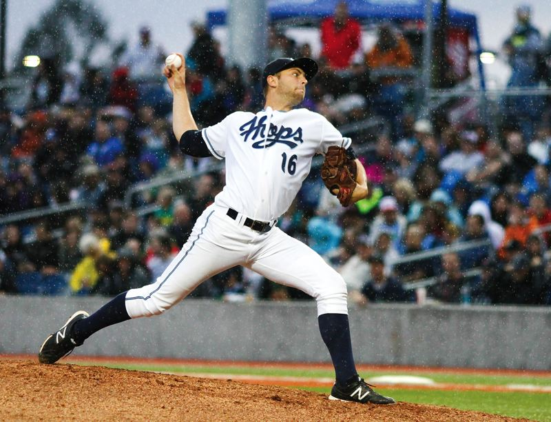 by: HILLSBORO TRIBUNE PHOTO: CHASE ALLGOOD - Hillsboro Hops starter Austin Platt delivers a pitch in the rain during Monday's Northwest League game against Boise. Platt pitched three innings before a rain delay ended his night.