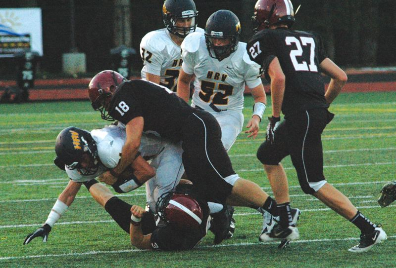 by: SANDY POST: PARKER LEE - Sandys Trystan Closner wraps up a tackle during the teams 47-21 win over Hood River.