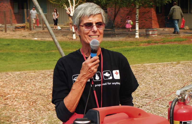 by: CONTRIBUTED PHOTO: CINDY AND BILL RAINEY - Red Cross volunteer Cindy Rainey, shown here at an emergency preparedness fair in Sisters in 2012, works to get her community ready to face any emergency.