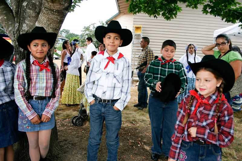 by: COURTESY PHOTOS: DIANA WUERTZ - (L to R) Andrea Marin, Julian Delgado, Alan Olvera and Venezia Pazos dress up in their best vaquero (cowboy and cowgirl) attire for St. Anthonys new Summer Fest fundraiser and for their performance of traditional vaquero dances.